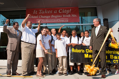 The Superintendent, the principal and the mayor join students for the ribbon cutting at the new Clemente Leadership Academy Wednesday.