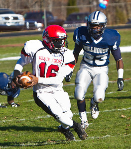 WC's Yasaan Frazier tries to stay ahead of Hillhouse's Derrick Gilliam in Thursday's annual Elm City Bowl.