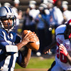 Hillhouse's Corey Maddox looks for a receiver versus Wilbur Cross in Thursday's annual Elm City Bowl.