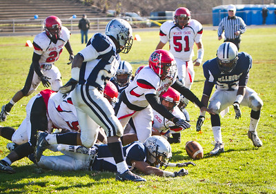 Wilbur Cross and Hillhouse players battle for a fumble in Thursday's annual Elm City Bowl.