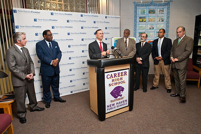 "College Summit's J. B. Schramm speaks at the launch of ""Pathway to Promise,"" a new preK-8 college-focused curriculum.  Watching the announcement, l-r, are Teachers union President David Cicarella, NHPS Superintendent Reggie Mayo, Hyde Leadership Academy Principal John Russell, Career HS Principal Michael Ceraso, New Haven Academy Facilitator Gregory Baldwin and Mayor John DeStefano."