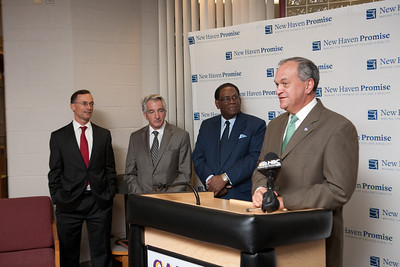 "New Haven Mayor John DeStefano announces the launch of ""Pathway to Promise,"" a new preK-8 college-focused curriculum.  Watching the announcement, l-r, are College Summit's J. B. Schramm, Teachers union President David Cicarella and Superintendent Reggie Mayo."