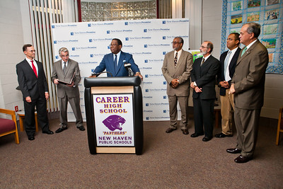 "NHPS Superintendent Reggie Mayo speaks at the launch of ""Pathway to Promise,"" a new preK-8 college-focused curriculum.  Watching the announcement, l-r, are College Summit's J. B. Schramm, Teachers union President David Cicarella, Career HS Principal Michael Ceraso, New Haven Academy Facilitator Gregory Baldwin and Mayor John DeStefano."