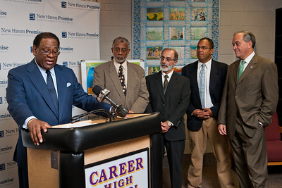 "NHPS Superintendent Reggie Mayo speaks at the launch of ""Pathway to Promise,"" a new preK-8 college-focused curriculum.  Watching the announcement, l-r, are Career HS Principal Michael Ceraso, New Haven Academy Facilitator Gregory Baldwin and Mayor John DeStefano."