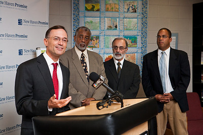 "College Summit's J. B. Schramm speaks at the launch of ""Pathway to Promise,"" a new preK-8 college-focused curriculum.  Watching the announcement, l-r, are Hyde Leadership Academy Principal John Russell, Career HS Principal Michael Ceraso and New Haven Academy Facilitator Gregory Baldwin."
