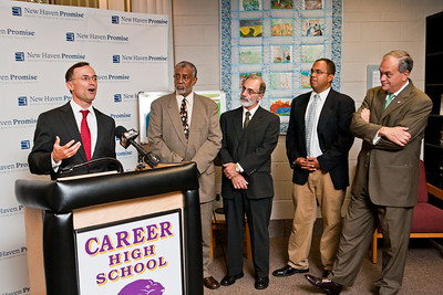 "College Summit's J. B. Schramm speaks at the launch of ""Pathway to Promise,"" a new preK-8 college-focused curriculum.  Watching the announcement, l-r, are Hyde Leadership Academy Principal John Russell, Career HS Principal Michael Ceraso, New Haven Academy Facilitator Gregory Baldwin and Mayor John DeStefano."