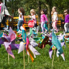 Children crossing the NH Green notice the hundreds of pinwheels plotted to mark the International Day of Peace Wednesday.