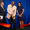 Floyd Little cuts the ribbon during the dedication of the new Floyd Little Athlletic Center. He is flanked by William Santillo and his wife DeBorah.