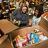 Wilbur Cross Math teacher Noelle Shipley helps students sort food donations for the holiday.