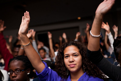 "Hillhouse senior Evelyn Folson raises her hand with most of her classmates is response to Hall-of-Fame football player Floyd Little's question, ""how many of you plan to go to college?""  during a special assembly with Little at the New Haven HS."