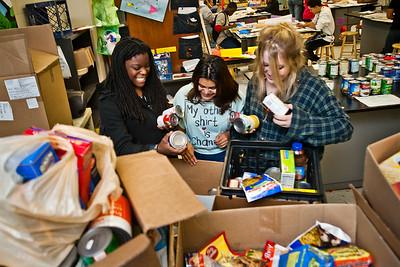 Wilbur Cross students Jaquana Ricks, Yolanda Benitez and Alessandra Hogan sort food donations for the holiday.