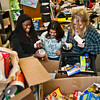 Wilbur Cross students Jaquana Ricks, Yolanda Benitez and Alessandra Hogan sort food donations for the holiday.