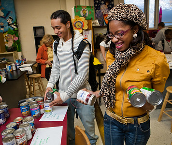 Brian Marrero and Darnesha Austin-Taylor of Wilbur Cross sort food donations for the holiday.