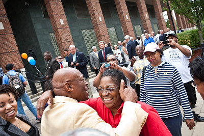Floyd Little greets friends, family and well-wishers during the dedication of the new Floyd Little Athletic Center in New Haven.