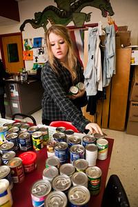 Wilbur Cross junior Alessandra Hogan sorts food donations for the holiday.