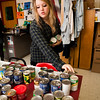 Wilbur Cross junior Alessandra Hogan sorts food donations for the holiday.