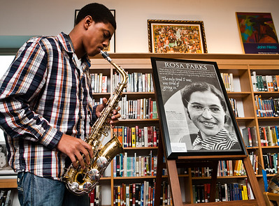 Hillhouse junior Corey Staggers performs during a special event at Hillhouse to honor the 56th anniversary of Rosa Parks refusal to give up her seat.