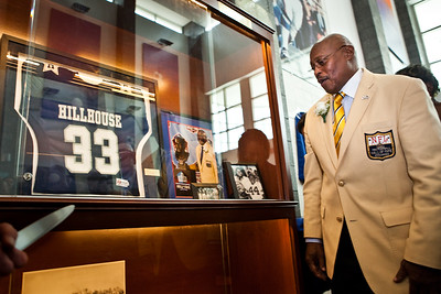 Floyd Little admires the new trophy case with his Hillhouse jersey during the dedication of the new Floyd Little Athletic Center in new haven