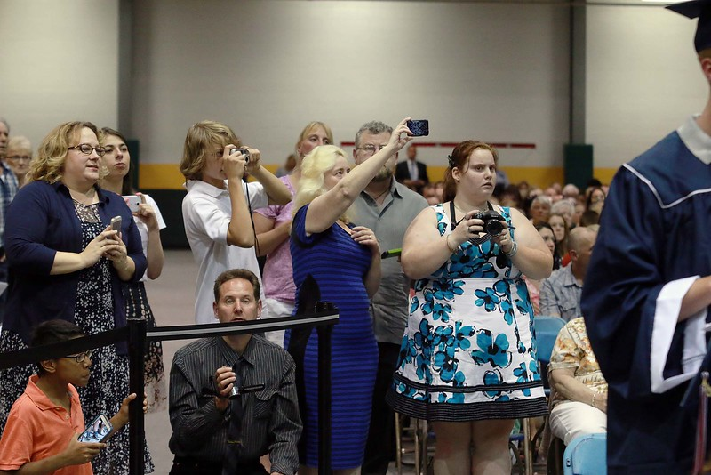 Parents, Family and friends try and take pictures of the North Middlesex Regional High School graduates at the Fitchburg State University Recreation Center during the  graduation on Friday night.  SENTINEL & ENTERPRISE/ JOHN LOVE
