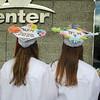 Katie Glauner and Emily Fleming show off their graduation caps after the Nashoba Regional High School graduation.<br /> SENTINEL AND ENTERPRISE/JULIA SARCINELLI