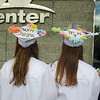 Katie Glauner and Emily Fleming show off their graduation caps after the Nashoba Regional High School graduation.<br /> SENTINEL AND ENTERPRISE/JULIA SARCINELLI