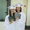 Twins Elise and Leanna Kline smile after graduating together from Nashoba Regional High School.<br /> SENTINEL AND ENTERPRISE/JULIA SARCINELLI