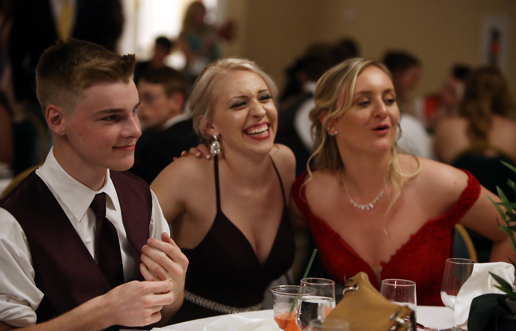 . Nashoba Tech prom. From left, Matt Mastroianni of Townsend, Colby Stacey of Lunenburg and Gabby Cartaglia of Chelmsford. (SUN/Julia Malakie)