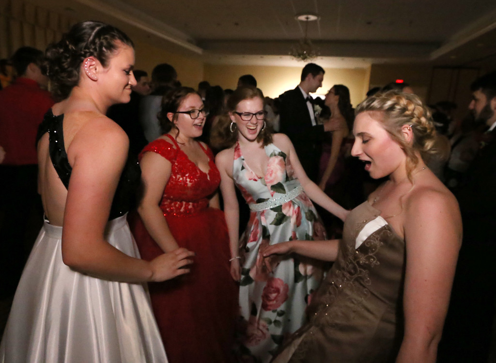 . Nashoba Tech prom. From left, KD Precewicz of Groton, Olivia Spoth of Pepperell, Ashley Conrad of North Chelmsford and Katie Carter of Chelmsford. (SUN/Julia Malakie)