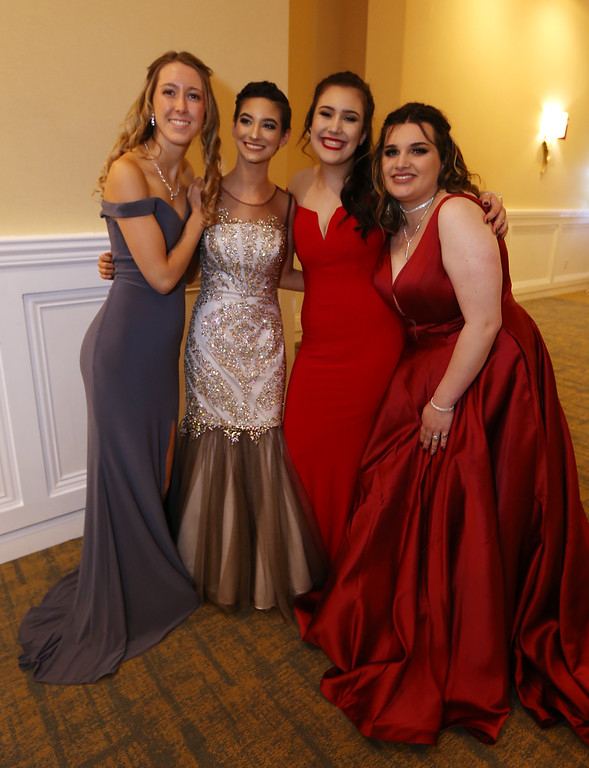 . Nashoba Tech prom. From left, Jenna Thompson of Littleton, Laryssa Tervail of Pepperell, Zelie Sears of Pepperell and Kam Adams of Tewksbury. (SUN/Julia Malakie)
