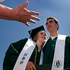 N0529NIWOT11.jpg N0530NIWOT11<br /> Niwot graduates Connor wood and his girlfriend Johanna Jensen embrace while family members take photos after the Niwot commencement ceremony on Saturday morning, May 29th, 2010.<br /> <br /> Photo by: Jonathan Castner