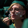 N0529NIWOT06.jpg N0530NIWOT06<br /> Niwot graduate Cayley Buie slyly blows bubbles during the Niwot commencement ceremony on Saturday morning, May 29th, 2010.<br /> <br /> Photo by: Jonathan Castner