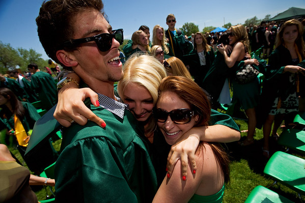 N0529NIWOT10.jpg N0530NIWOT10<br /> Niwot graduates: David Perry, Olivia Perry and Alex Oliver hug at the end of the Niwot commencement ceremony on Saturday morning, May 29th, 2010.<br /> <br /> Photo by: Jonathan Castner