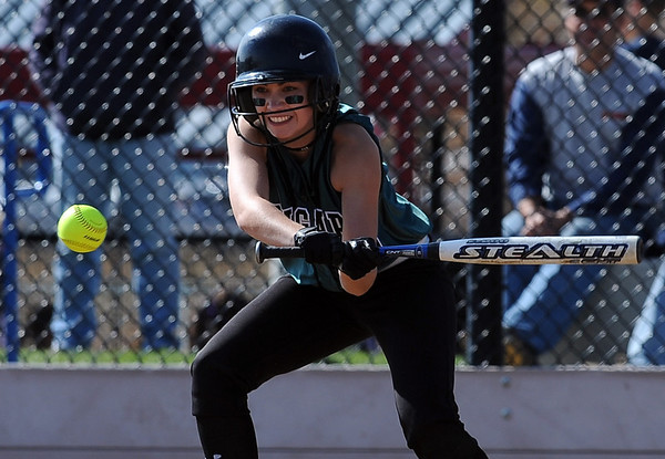 Anna Jones  of Niwot gets the bat on the ball against Evergreen during the 4A state playoffs.<br /> Cliff Grassmick / October 23, 2009
