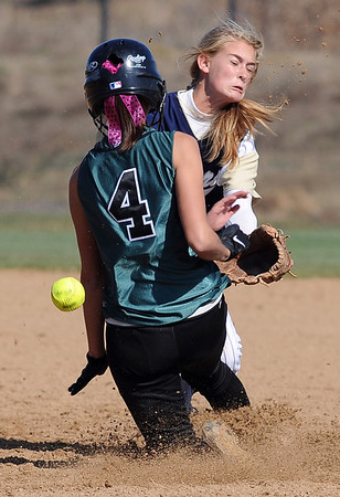 "The ball hits Amy Keschl of Niwot in the back as she slides into Bailey Doctor of Evergreen during the 4A state playoffs in Aurora on Friday.<br /> For more photos of the game, go to  <a href=""http://www.dailycamera.com"">http://www.dailycamera.com</a><br /> Cliff Grassmick / October 23, 2009"