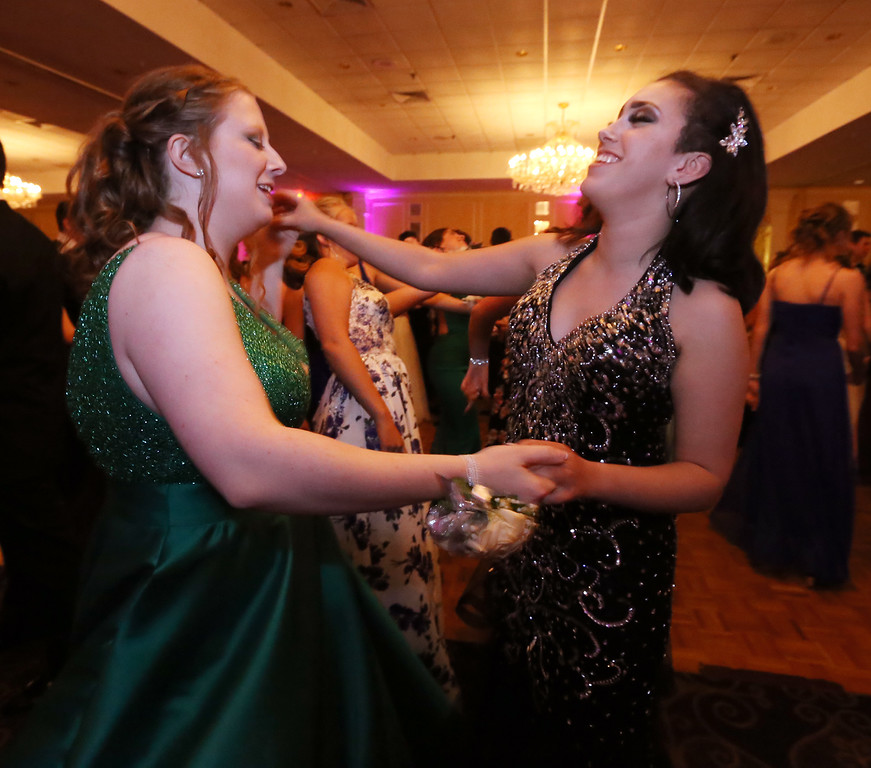 . North Middlesex Regional High School prom at Radisson Nashua. Lexi Poindexter of Townsend, left, and Savannah Martin of Pepperell. (SUN/Julia Malakie)