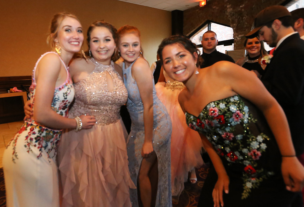 . North Middlesex Regional High School prom at Radisson Nashua. From left, Calista Carter of Townsend, Serena Wheeler of Ashby, Alina Francia of Townsend and Kenzie Ozog of Townsend. (SUN/Julia Malakie)
