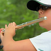 Overlook Middle School  seventh grader Olivia Smith, 12, plays the flute during band camp at Camp Winnekeag Youth Camp in Ashburnham on Tuesday afternoon. SENTINEL & ENTERPRISE/JOHN LOVE