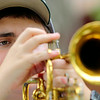 Oakmont Regional High School freshman James Beaudry, 14, plays the Cornet during band camp at Camp Winnekeag Youth Camp in Ashburnham on Tuesday afternoon. SENTINEL & ENTERPRISE/JOHN LOVE