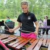 Oakmont Regional High School junior Jess Uminski, 16, plays the marimba during band camp at Camp Winnekeag Youth Camp in Ashburnham on Tuesday afternoon. SENTINEL & ENTERPRISE/JOHN LOVE