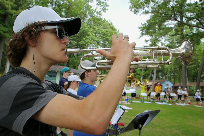 Oakmont Regional High School senior Joe Mellish, 17,  plays the trumpet during band camp at Camp Winnekeag Youth Camp in Ashburnham on Tuesday afternoon. SENTINEL & ENTERPRISE/JOHN LOVE