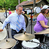 Secretary of Education Matthew Malone tries to create some music as he get right in to the middle of the action to learn a little from Sylvia Broome, 14, about the Rack she played at Camp Winnekeag Youth Camp in Ashburnham on Tuesday afternoon. SENTINEL & ENTERPRISE/JOHN LOVE
