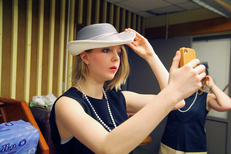 Students in Oakmont Regional High School's musical Thoroughly Modern Millie get ready for opening night show on Thursday. Making sue her look is just right by using her carmera on her phone is Brooke Aubin who plays on of the speed tappist an a member of the ensemble. SENTINEL & ENTERPRISE/JOHN LOVE
