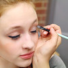 Students in Oakmont Regional High School's musical Thoroughly Modern Millie get ready for opening night show on Thursday. Erin Theriault one of the actors in the ensemble gets her makeup on to be ready for their performance. SENTINEL & ENTERPRISE/JOHN LOVE