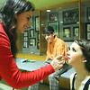 Students in Oakmont Regional High School's musical Thoroughly Modern Millie get ready for opening night show on Thursday. Olivia Ryan playing Mrs Meers helps Maeve Bradley playing Millie Dillmount with her makeup as Nathan Shedd playing Jimmy Smith looks on already in costume. SENTINEL & ENTERPRISE/JOHN LOVE