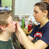 Students in Oakmont Regional High School's musical Thoroughly Modern Millie get ready for opening night show on Thursday. Jordan Jones playing Mrs Flannery helps Mike Rellstab playing Trevor Graydon wiht his make up in the room behind the stage as they get ready for the performance. SENTINEL & ENTERPRISE/JOHN LOVE