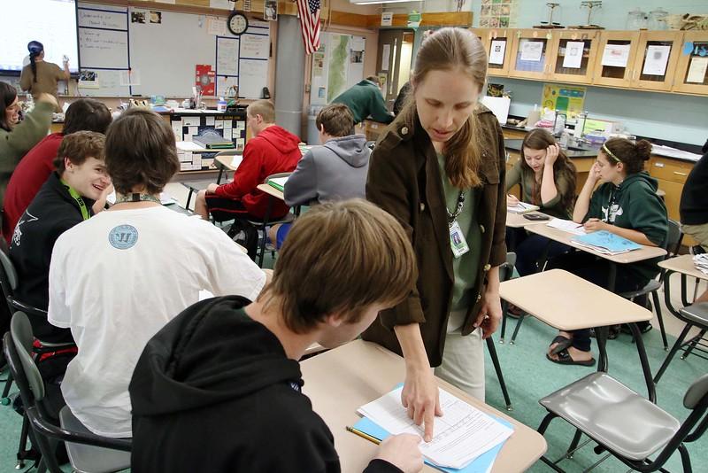 Oakmont Regional High School biology teacher Laurie Rheault teaches evolution on Monday afternoon in her class. SENTINEL & ENTERPRISE/ JOHN LOVE