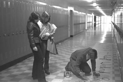 Nina and Lorian supervise Jon-D's hallway handiwork.