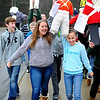 Overlook Middle School 8th graders, including (from left) Ben Telicki, Macie Hytonen, and Julia Kiedaisch, march holding British effigies during a simulation of a Patriot protest against the British king and his policies, Thursday at the school in Ashburnham, as the students have recently been learning about colonial America.<br /> SENTINEL & ENTERPRISE / BRETT CRAWFORD