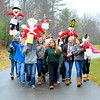 Overlook Middle School history teacher Patricia O'Brien (left) leads a group of 8th graders in a march around the Ashburnham school with British effigies during a simulation of a Patriot protest against the British king and his policies, as the students have recently been learning about colonial America, Thursday morning.<br /> SENTINEL & ENTERPRISE / BRETT CRAWFORD