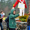 Overlook Middle School 8th-grader Matt Bourekas marches with classmates while holding a British effigy during a simulation of a Patriot protest against the British king and his policies, Thursday at the school in Ashburnham, as the students have recently been learning about colonial America.<br /> SENTINEL & ENTERPRISE / BRETT CRAWFORD